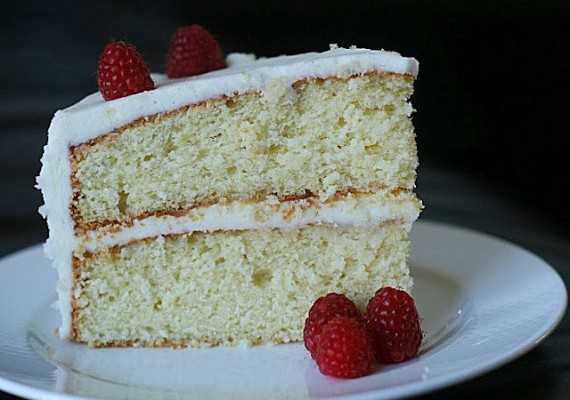Vanilla Cake With Vanilla Frosting And Raspberries